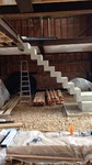 Finished concrete stair, free standing in a converted barn.